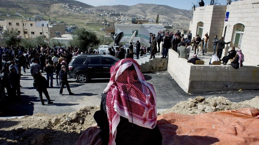 A relative of slain Jordanian pilot, Lt. Muath al-Kaseasbeh attends the Kaseasbeh tribe gathering divan at their home village of Ai, near Karak, Jordan, Wednesday, Feb. 4, 2015. Outrage and condemnation poured across the Middle East on Wednesday as horrified people learned of the video purportedly showing the Islamic State group burn a Jordanian pilot to death. (AP Photo/Nasser Nasser)