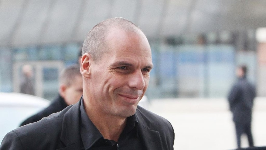 Greek Finance Minister Yanis Varoufakis arrives at the European Central Bank in Frankfurt, Germany Wednesday, Feb. 4, 2015. (AP Photo/Michael Probst)