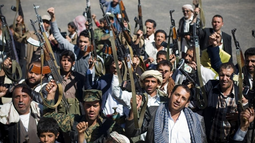 Houthi Shiite Yemenis hold their weapons during a rally to show support for their comrades in Sanaa, Yemen, Wednesday, Feb. 4, 2015. (AP Photo/Hani Mohammed)