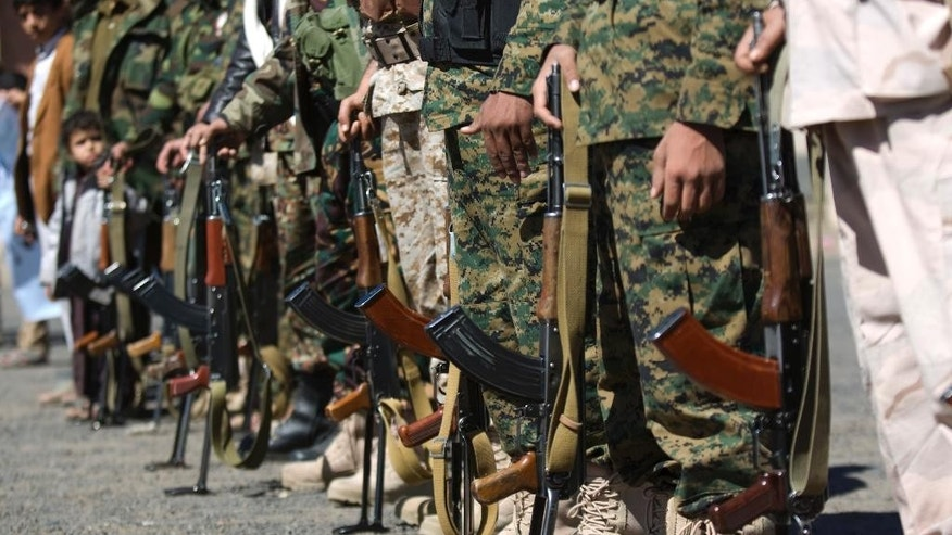 Houthi Shiite Yemenis wearing army uniforms hold their weapons during a rally to show support for their comrades in Sanaa, Yemen, Wednesday, Feb. 4, 2015. (AP Photo/Hani Mohammed)