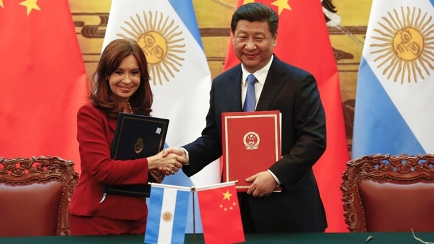 Feb. 4, 2015: Chinese President Xi Jinping, right, and Argentinian President Cristina Fernandez shake hands after signing documents following their meeting at the Great Hall of the People in Beijing. (AP Photo/Rolex Dela Pena)