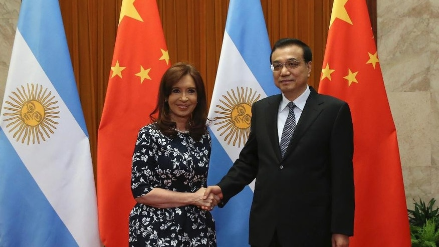 Argentine President Cristina Fernandez de Kirchner, left, poses with Chinese Premier Li Keqiang at the start of a meeting at the Great Hall of the People in Beijing Thursday, Feb. 5, 2015. Beijing is strengthening its relations with the South American country. (AP Photo/Wu Hong, Pool)