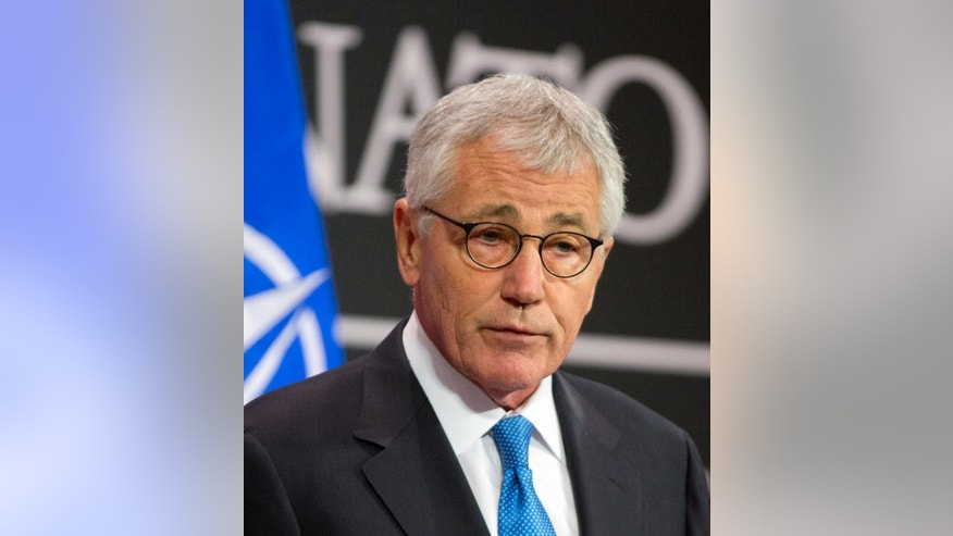 U.S. Secretary of Defense Chuck Hagel speaks during a media conference at NATO headquarters in Brussels on Thursday, Feb. 5, 2015. NATO's chief announced Thursday the alliance is set to more than double the size of its Response Force in response to Russian aggression in Ukraine and the challenge of Islamic extremism. NATO secretary-general Jens Stoltenberg, speaking to reporters before the opening of a meeting of defense ministers, said they were expected to agree to boost the size of the force from 13,000 to 30,000. (AP Photo/Virginia Mayo)