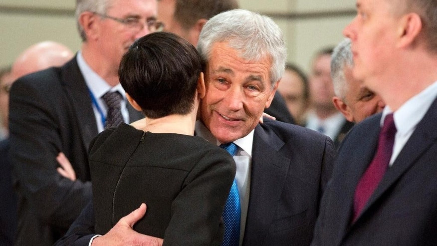 U.S. Secretary of Defense Chuck Hagel, center right, greets Norwegian Defense Minister Ine Marie Eriksen Soreide center left, during the NATO-Georgia Commission at the level of defense ministers at NATO headquarters in Brussels on Thursday, Feb. 5, 2015. NATO defense ministers meet Thursday to discuss terrorism, the situation in Ukraine and the size and composition of the new spearhead force. (AP Photo/Virginia Mayo)