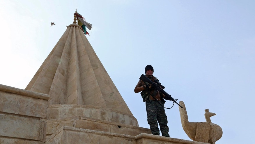 Jan. 11, 2015: Yazidi fighters protects the Sharaf al-Deen temple shrine, one of the holiest for the Yazidis, a religious minority whom the Islamic State group considers heretics ripe for slaughter