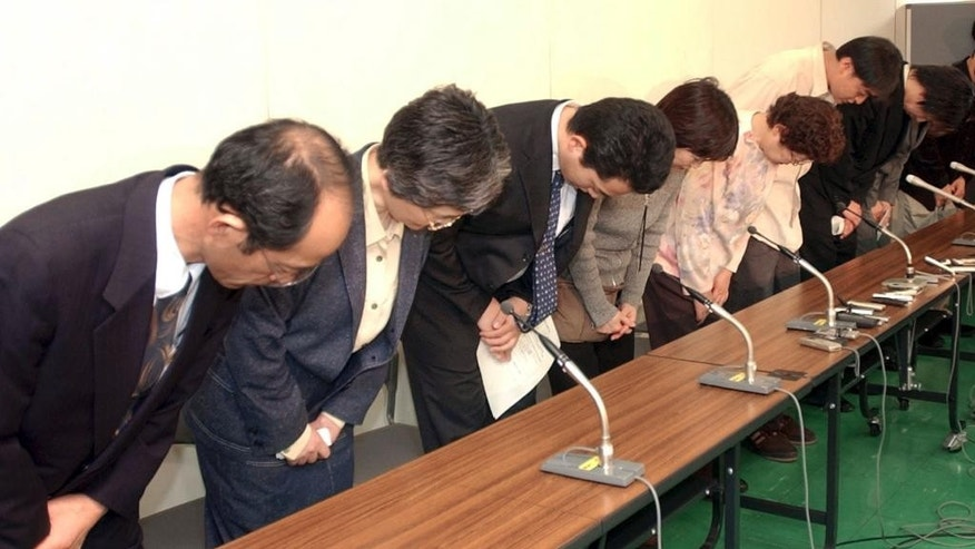 "FILE - In this April 12, 2004 file photo, relatives of the three Japanese hostages being held in Iraq bow before reporters in Tokyo. When the young Japanese anti-war activists were taken hostage in Iraq and later freed in 2004, they faced nationwide bashing as troublemakers and had to cover their own medical check and part of chartered flight home. Behind the sympathy Japanese are voicing over their two countrymen, Kenji Goto and Haruna Yukawa, purportedly slain by the Islamic State group is a widespread view that they were ""troublemakers."" Many feel that they wouldn't have had to face this new sense of insecurity, unwelcomed attention from the Islamic State group and elsewhere in the world on the Japanese, if the two men had not ignored warnings against travel to Syria and were taken hostage by the militant and then purportedly beheaded. (AP Photo/Koji Sasahara, File)"