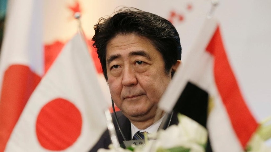"FILE - In this Jan. 17, 2015 file photo, Japanese Prime Minister Shinzo Abe attends a joint meeting of the Japan-Egypt business committee in Cairo, Egypt. Behind the sympathy Japanese are voicing over their two countrymen purportedly slain by the Islamic State group is a widespread view that they were ""troublemakers."" And the Prime Minister Abe is too. Many feel that they wouldn't have had to face this new sense of insecurity, unwelcomed attention from the Islamic State group and elsewhere in the world on the Japanese, if Abe had not showcased Tokyo's support for the multi-national coalition against the extremists. (AP Photo/Hassan Ammar, File)"