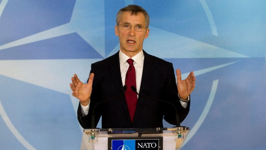 NATO Secretary General Jens Stoltenberg speaks during a media conference at NATO headquarters in Brussels on Thursday, Feb. 5, 2015. NATO defense ministers meet Thursday to discuss terrorism, the situation in Ukraine and the size and composition of the new spearhead force. (AP Photo/Virginia Mayo)