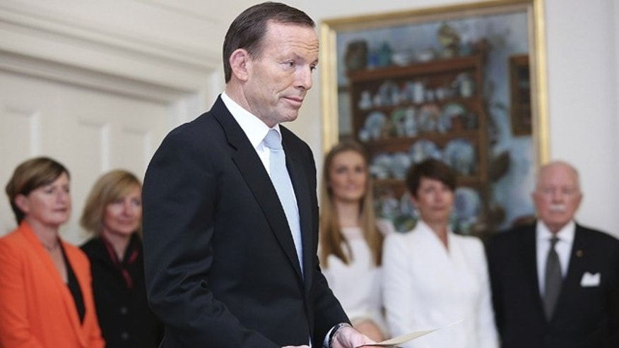 FILE - In this Sept. 18, 2013 file photo, Tony Abbott is sworn in as the 28th prime minister of Australia at Government House in Canberra, Australia. (AP Photo/Stefan Postles, Pool, File)