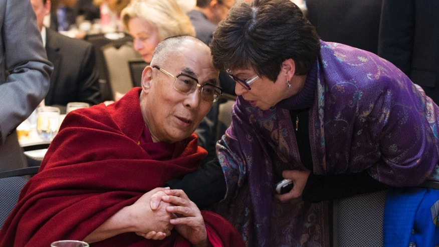 Feb. 5, 2015: Valerie Jarrett, senior adviser to President Barack Obama, right, talks with the Dalai Lama during the National Prayer Breakfast in Washington.