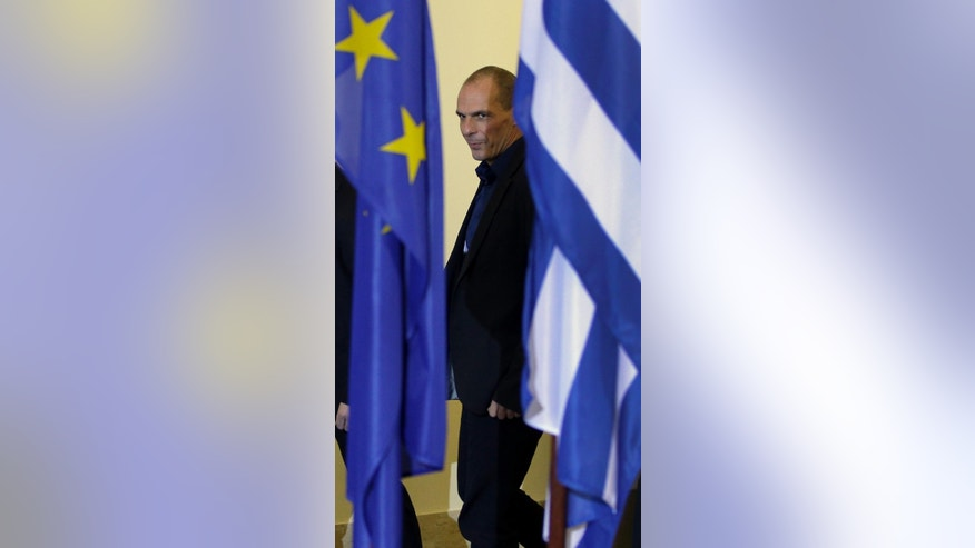 The Finance Minister of Greece, Yanis Varoufakis, right, arrives for a joint press conference with German Finance Minister Wolfgang Schaeuble as part of a meeting in Berlin, Germany, Thursday, Feb. 5, 2015. (AP Photo/Michael Sohn)