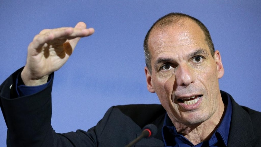The Finance Minister of Greece, Yanis Varoufakis, gestures during a joint press conference with German Finance Minister Wolfgang Schaeuble as part of a meeting in Berlin, Germany, Thursday, Feb. 5, 2015. (AP Photo/Michael Sohn)