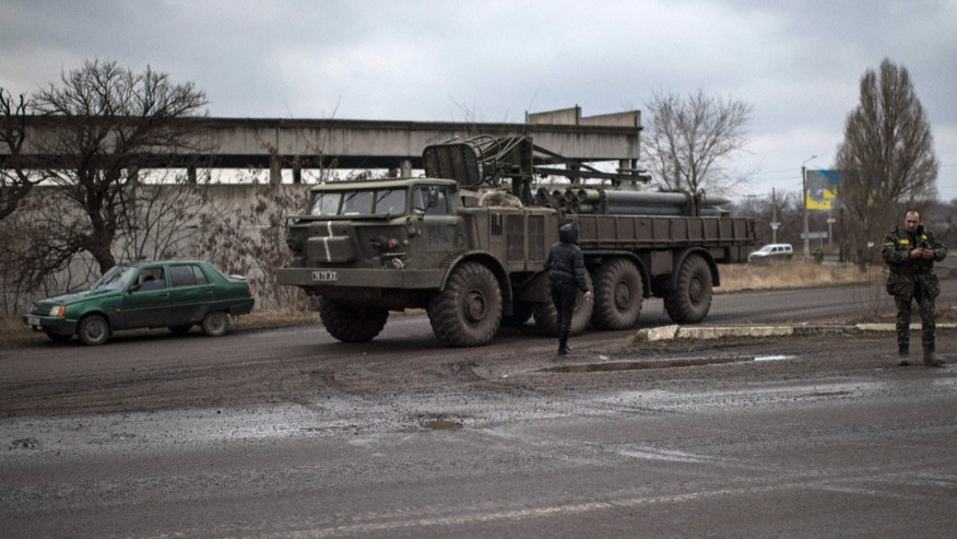 Feb. 6, 2015 - A Ukrainian military vehicle on a road near Artemivsk, eastern Ukraine. A new report says hundreds of babies were born in the war-torn country with HIV unnecessarily last year due to a shortage of vital drugs.
