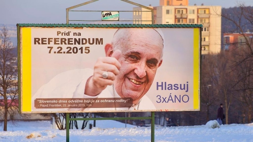 "A billboard depicting Pope Francis with his thumb up located at Klokocina district in Nitra, Slovakia, Thursday, Feb. 5, 2015, invites voters to the Slovak national referendum on the protection of the traditional family scheduled for Saturday, Feb. 7. Billboard slogans read (in clock-wise direction from left upper corner: ""Come to referendum 7.2.2015"", ""Vote 3xYES"" and "" ´Slovakia fights brave today for the protection of the traditional family´ (as a quotation) - Pope Francis, Jan. 22, 2015, in Rome"". The vote this weekend, which aims to reinforce the constitutional ban on same-sex marriages, and restrict the rights of gays to adopt children in this predominantly Roman Catholic nation follows a similar one that succeeded in Croatia in 2013 and points to a cultural divide within the European Union in which more established western members are rapidly granting new rights to gays, while eastern newcomers entrench conservative attitudes toward LGBT people.(AP Photo/CTK, Jano Koller)"