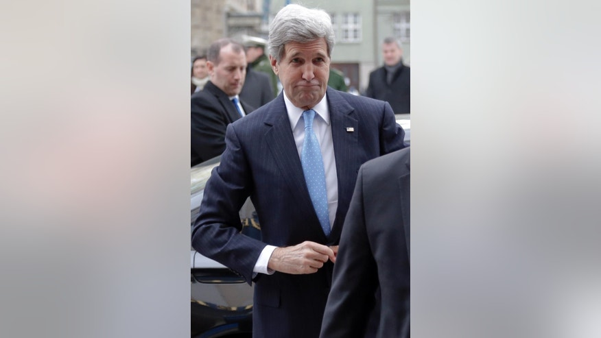 U.S. Secretary of State John Kerry arrives for the 51.  Security Conference in Munich, Germany, Friday, Feb. 6, 2015. The conference on security policy takes place from Feb. 6, 2015 until Feb. 8, 2015. (AP Photo/Matthias Schrader)