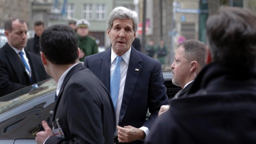 U.S. Secretary of State John Kerry arrives for the 51th Security Conference in Munich, Germany, Friday, Feb. 6, 2015. The conference on security policy takes place from Feb. 6, 2015 until Feb. 8, 2015. (AP Photo/Matthias Schrader)