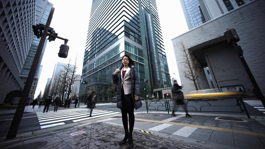 Jan. 21, 2015 - Eriko Sekiguchi, 36, in Tokyo. Often toiling 14 hours a day for a major trading company, including early morning meetings and after-hours, Sekiguchi used just 8 of her 20 paid vacation days last year. 6 were for being sick.