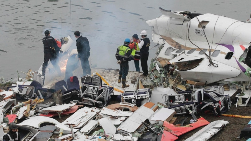 Feb. 5, 2015: Emergency teams break down pieces of wreckage at the site of a commercial plane crash in Taipei, Taiwan.