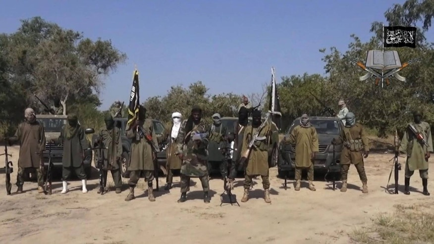 Oct. 31, 2014: Abubakar Shekau, centre, the leader of Nigeria's Islamic extremist group.