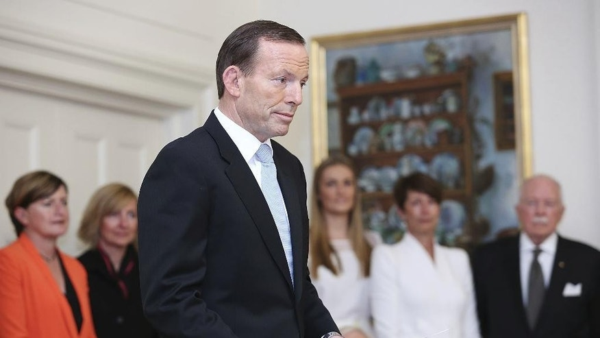 FILE - In this Sept. 18, 2013 file photo, Tony Abbott is sworn in as the 28th prime minister of Australia at Government House in Canberra, Australia.  Prime Minister Abbott said Sunday, Feb. 8, 2015, he has moved up a challenge to his own leadership to Monday in the interests of ending uncertainty about his government's direction. (AP Photo/Stefan Postles, Pool, File)