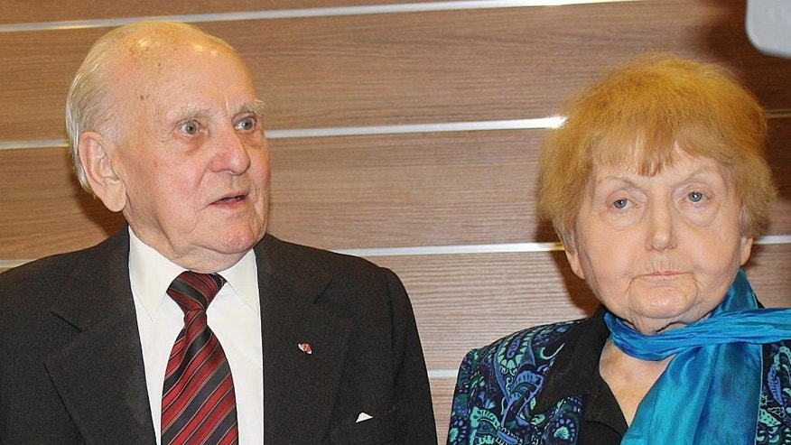 "In this Jan. 29 2015 picture Jozef Paczynski,left, 95, a former Auschwitz prisoner who was the barber to camp commandant Rudolf Hoess, stands next to Eva Mozes Kor, 81, a Jewish survivor of experiments by the sadistic German doctor Josef Mengele, in Krakow, Poland.  Paczynski spoke to a group about his experiences cutting Hoess' hair for four years. He said he has been asked over and over why he didn't use his sharp instruments to slit the throat of the mass murderer. ""I thought about it,"" Paczynski said. ""But when I realized what the consequences would be I simply could not do it."".  (AP Photo/Alexandra Fletcher)"