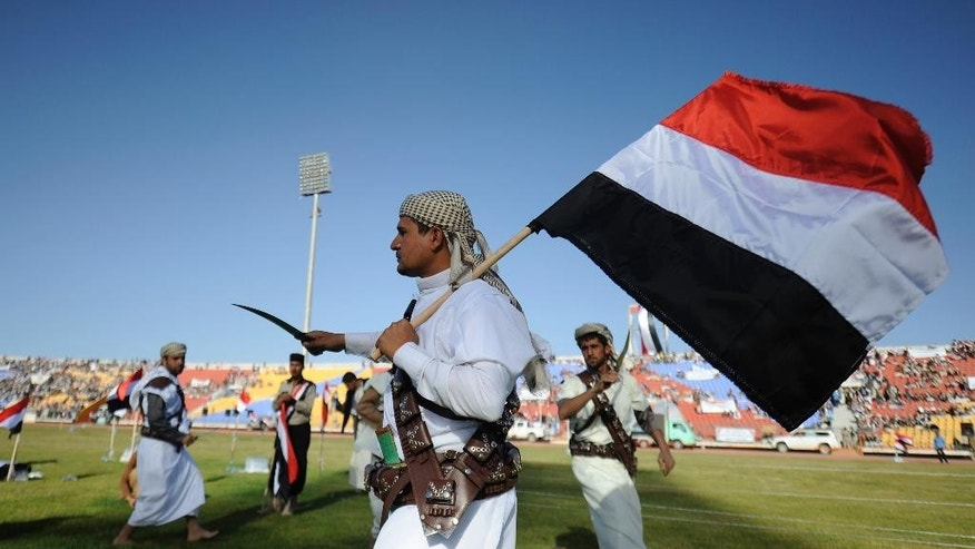 "Supporters of Houthi Shiites, who took over the government of Yemen and installed a new committee to govern, dance with traditional daggers at a rally in support of the Houthis, at a sports stadium in Sanaa, Yemen, Saturday, Feb. 7, 2015. A group of Gulf countries denounced the Shiite rebel takeover of Yemen as a ""coup"" Saturday, calling for the United Nations to take action as thousands demonstrated in the streets against their power grab. (AP Photo/Hani Mohammed)"