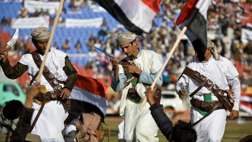 "Supporters of Houthi Shiites, who took over the government of Yemen and installed a new committee to govern, wave traditional daggers and dance at a rally in support of the Houthis, at a sports stadium in Sanaa, Yemen, Saturday, Feb. 7, 2015. The six Arab countries of the Gulf Cooperation Council denounced the Shiite rebel takeover of Yemen as a ""coup"" Saturday, calling for the United Nations to take action as thousands demonstrated in the streets against their power grab. (AP Photo/Hani Mohammed)"