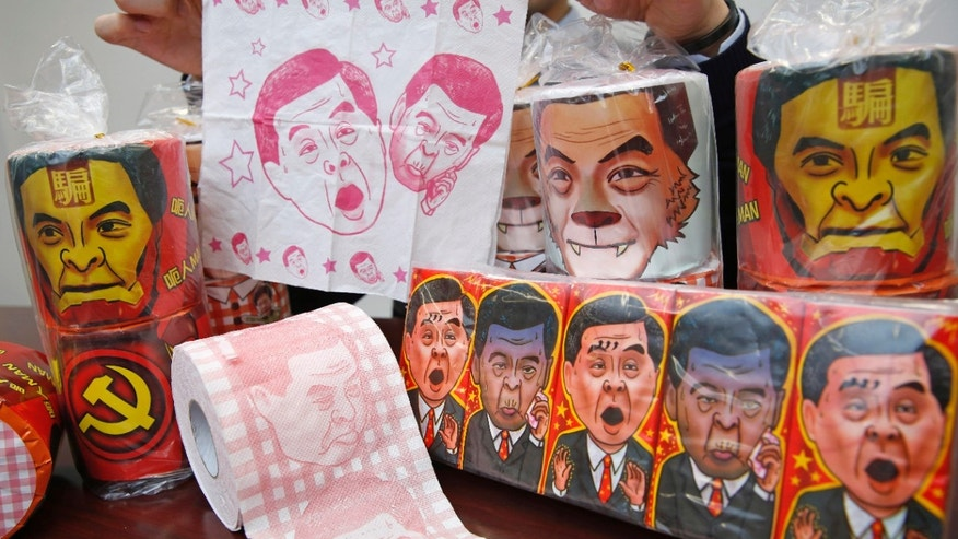 FEb. 7, 2015: olls of toilet paper and packages of tissue paper printed with images of pro-Beijing Hong Kong Chief Executive Leung Chun-ying.