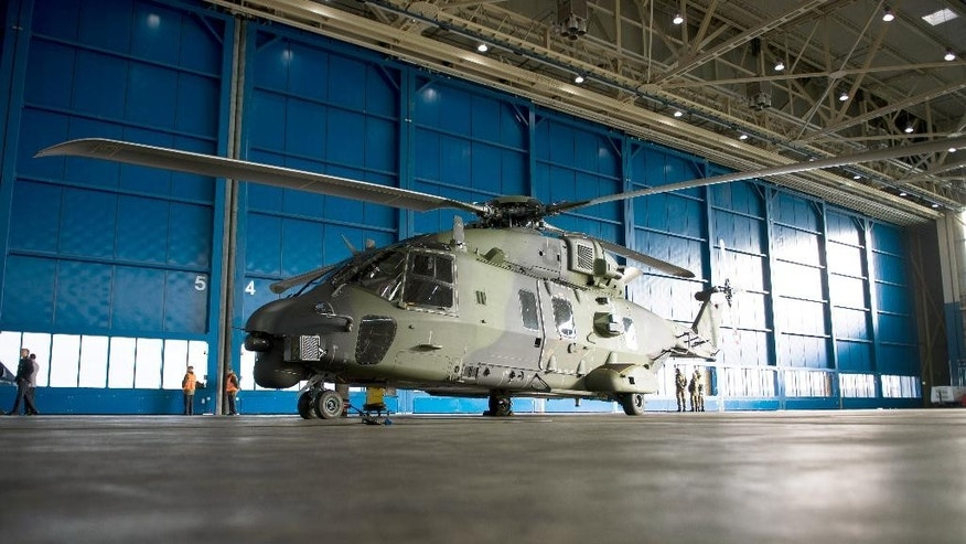 FILE - In this Jan. 7, 2015 file picture a NH90 (NATO-Helicopter 90), stands at the mulitary airport of Cologne. The German military has stopped all routine flights with its NH90 multi-function helicopters because of a design flaw. The Defense Ministry said in a statement Friday Feb. 6, 2015 that the problem was discovered by technicians investigating the explosion of a German NH90's engine in Uzbekistan in June. Germany has some 35 NH90 helicopters, which are used to carry heavy loads or transport up to 20 troops.  (AP Photo/dpa, Maja Hitij,file)