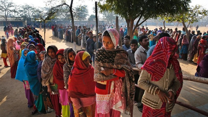 Indians wait in a queue to cast their votes at a polling booth in New Delhi, India, Saturday, Feb. 7, 2015. Voters cast ballots in the Indian capital on Saturday in an election that is seen as a litmus test for the popularity of Prime Minister Narendra Modi and his Hindu nationalist party. Opinion polls ahead of the vote to choose New Delhi's 70-member assembly suggest that Modi's Bharatiya Janata Party is either locked in a close contest with the upstart Common Man's Party or will come in second. (AP Photo/Manish Swarup)