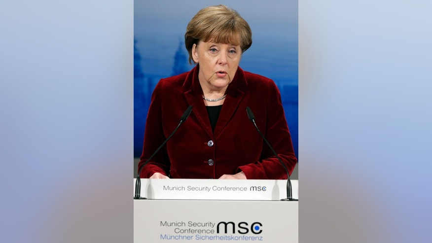 "German Chancellor Angela Merkel delivers  her speech at the 51.  Munich Security Conference in Munich, Germany, Saturday, Feb. 7, 2015. The conference on security policy takes place from Feb. 6, 2015 until Feb. 8, 2015. German Chancellor Angela Merkel says it's still uncertain whether a flurry of democracy aimed at resolving the crisis in Ukraine will succeed. Merkel insisted Saturday after returning from talks in Moscow the previous night that ""this crisis cannot be solved by military means.""  (AP Photo/Matthias Schrader)"