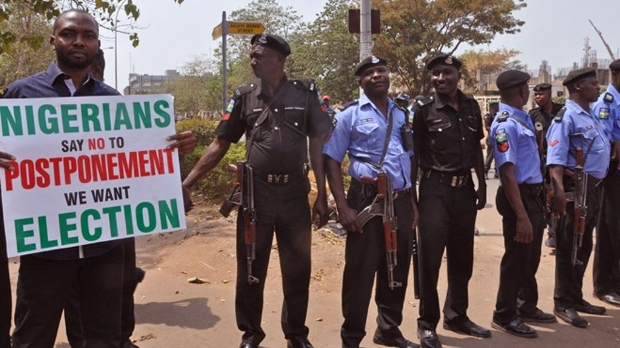 Feb. 7, 2015: Nigerian Police provide security in Abuja, Nigeria as people demonstrate against the possible postponement of the Nigerian elections. (AP)