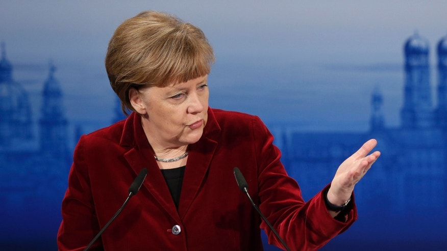 Feb. 7, 2015: German Chancellor Angela Merkel gestures during her speech at the 51. Munich Security Conference in Munich, Germany.