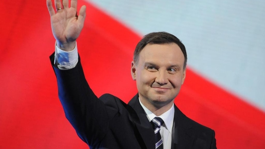 Candidate of Poland's main conservative opposition party Law and Justice in the May presidential elections, Andrzej Duda, greets supporters during a festive opening of his campaign in Warsaw, Poland, Saturday, Feb. 7, 2015. (AP Photo/Alik Keplicz)