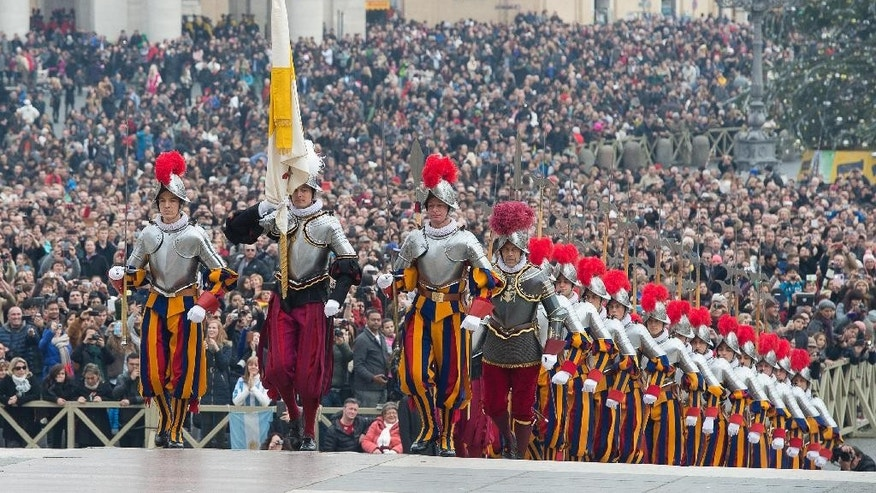 An undated but recent photo of Lt. Col. Christoph Graf, fourth from left. The Vatican announced Saturday, Feb. 7, 2015 that Pope Francis has promoted the No. 2 officer of the Swiss Guards to commander of the colorful, 500-year-old army, whose members take an oath to protect pontiffs. Graf, who joined the Guards in 1987, takes the place of Col. Daniel Anrig, who had been commander since 2008. (AP Photo/L'Osservatore Romano, pool)
