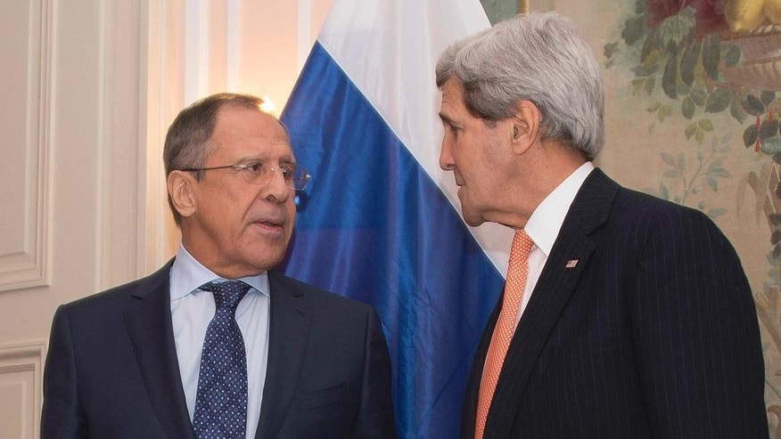 Secretary of State John Kerry talks with Russian Foreign Minister Sergey Lavrov at the start of their bilateral meeting at the 51st Munich Security Conference (MSC) in Munich,  Germany, Saturday, Feb. 7, 2015. (AP Photo/Jim Watson, Pool)
