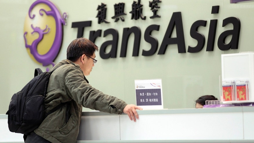 Feb. 7, 2015: A passenger waits at the ticket counter of TransAsia Airways at the Songshan Airport in Taipei, Taiwan.
