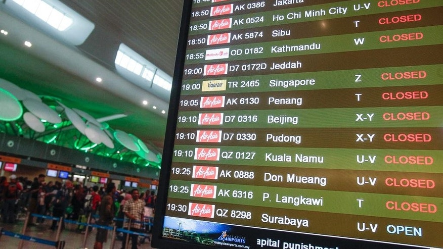 An information board shows AirAsia Flight D7172 at Kuala Lumpur International Airport 2 in Sepang, Malaysia, Sunday, Feb. 8, 2015. AirAsia X said the flight heading from Malaysia to Saudi Arabia turned back shortly after takeoff due to a technical problem, circling for hours to burn fuel before landing safely in Kuala Lumpur. (AP Photo/Joshua Paul)