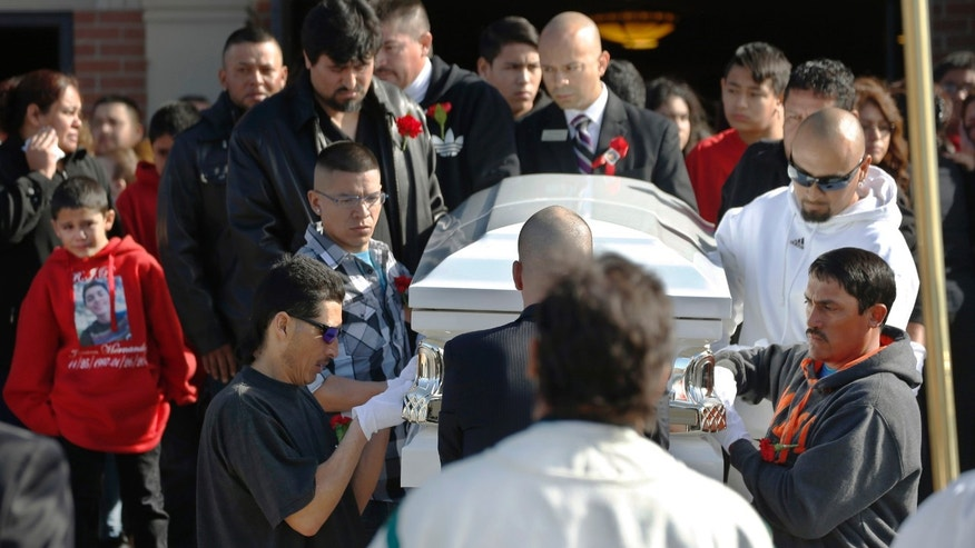 Pallbearers bring the casket of 17-year-old Jessica Hernandez out of the church to a waiting hearse after a funeral Mass in Westminster, Colo. on Saturday, Feb. 7, 2015. Police say Hernandez was shot Jan. 26 after she drove a stolen car toward an officer in a residential alley in Denver. A passenger in the car disputes the police account and says officers fired first. The shooting sparked protests and demands for an outside prosecutor to investigate what happened. (AP Photo/David Zalubowski)