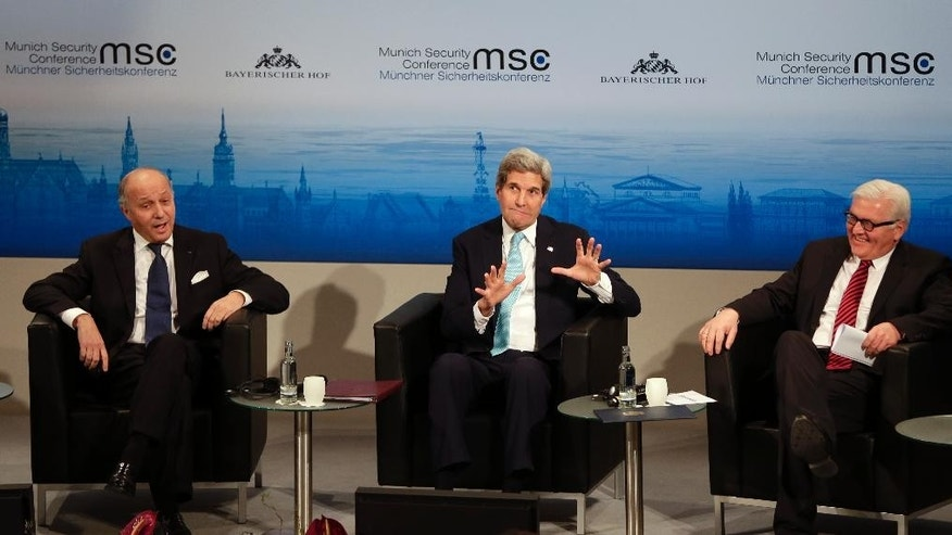 U.S. Secretary of State John Kerry, center, speaks, as French Foreign Minister Laurent Fabius, left,  and German Foreign Minister Frank-Walter Steinmeier listen on the last day of the  51. Security Conference in Munich, Germany, Sunday, Feb. 8, 2015. (AP Photo/Matthias Schrader)