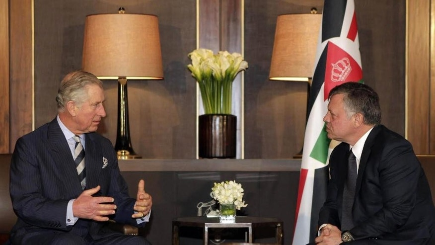Britain's Prince Charles, left, meets with Jordan's King Abdullah II in Amman, Jordan, Sunday, Feb. 8, 2015. (AP Photo/Khalil Mazrawi, Pool)