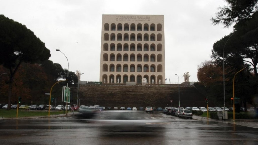 Dec. 22, 2009: In this file photo, cars speed along the EUR district, with the Palazzo della Civilta' Italiana (Palace of the Italian Civilisation) in background, in Rome. (AP)