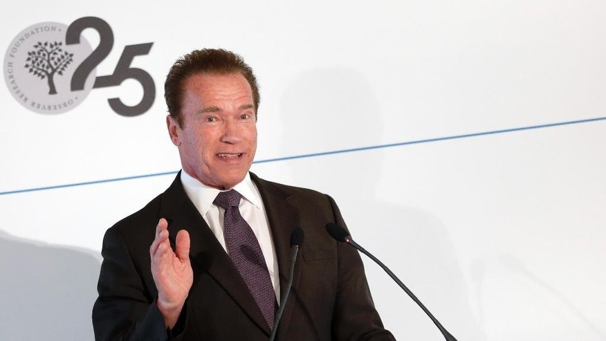 "Former California governor and Hollywood star Arnold Schwarzenegger delivers a speech  at the sideline of  the 51. Security Conference in Munich, Germany, Sunday, Feb. 8, 2015.  Arnold Schwarzenegger is calling more to be done to combat climate change, calling it ""the issue of our time."" Speaking Sunday to a small group at the Munich security conference introducing a new policy paper ""The Future of Energy,"" Schwarzenegger said his experience in California was that the adoption of green energy creates jobs, while leading to energy independence.   (AP Photo/Matthias Schrader)"