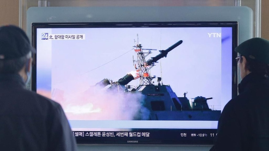South Korean men watch a TV news program on the launch of North Korea's new anti-ship cruise missile, at Seoul train station in Seoul, South Korea, Sunday, Feb. 8, 2015. North Korea said Saturday that it has test-fired a new anti-ship cruise missile, a move experts in Seoul viewed as an attempt to raise tensions ahead of joint military drills between the United States and South Korea.(AP Photo/Ahn Young-joon)