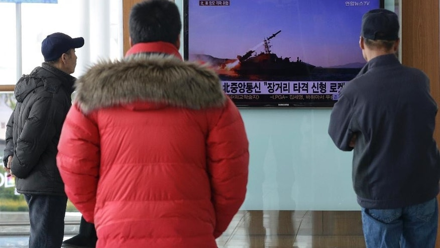 "South Korean men watch a TV news program on the launch of North Korea's new anti-ship cruise missile, at Seoul train station in Seoul, South Korea, Sunday, Feb. 8, 2015. North Korea said Saturday that it has test-fired a new anti-ship cruise missile, a move experts in Seoul viewed as an attempt to raise tensions ahead of joint military drills between the United States and South Korea. The letters on the screen read ""North Korea's Korean Central News Agency is saying fired a new anti-ship cruise missile"". (AP Photo/Ahn Young-joon)"