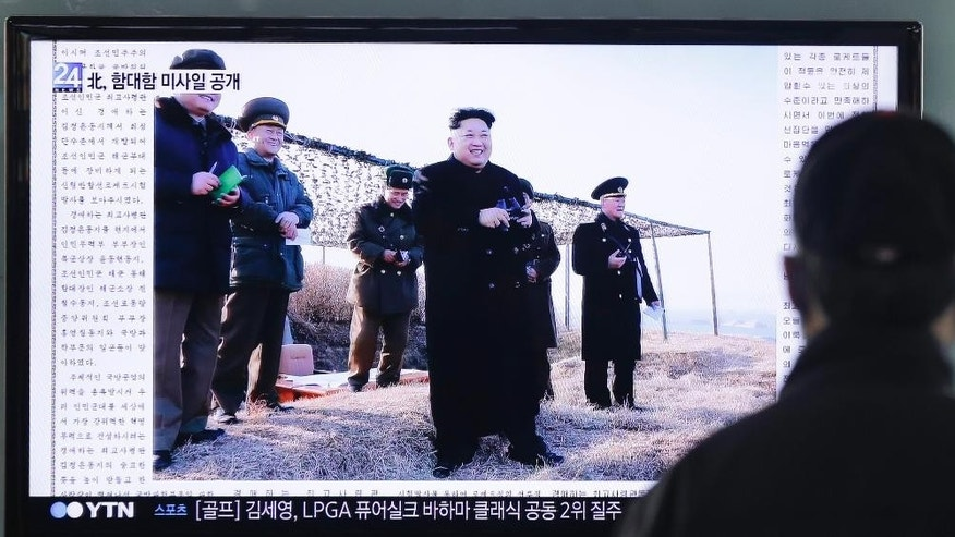 A man watches a TV news program showing that North Korea's Rodong Sinmun newspaper front-pages a photo of North Korean leader Kim Jong Un, center,  on-site to watch the testing of a new missile, at Seoul train station in Seoul, South Korea, Sunday, Feb. 8, 2015. North Korea said Saturday that it has test-fired a new anti-ship cruise missile, a move experts in Seoul viewed as an attempt to raise tensions ahead of joint military drills between the United States and South Korea.(AP Photo/Ahn Young-joon)