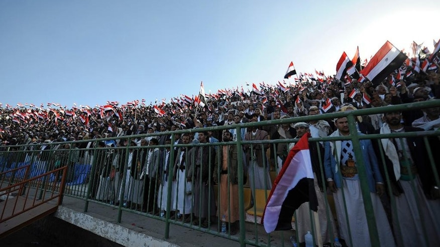 Feb. 7, 2015: Supporters of Houthi Shiite stand for the national anthem during a rally in support of the Houthis at a sports stadium in Sanaa, Yemen. (AP)