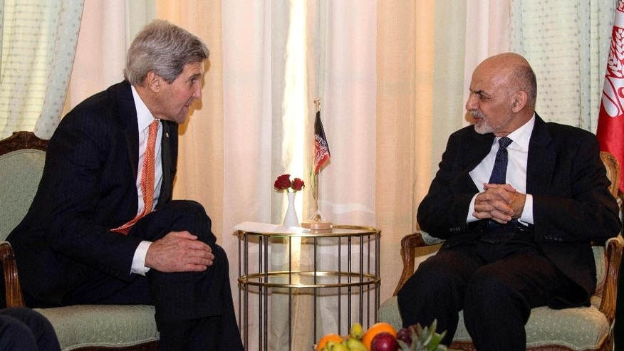 "Secretary of State John Kerry talks with Afghanistan President Mohammad Ashraf Ghani during a bilateral meeting at the 51st Munich Security Conference (MSC) in Munich, Germany, Saturday, Feb. 7, 2015. The Ukraine conflict, Islamic State group jihadists and the wider ""collapse of the global order"" occupy the world's security community at the three-day annual meeting.  (AP Photo/Jim Watson, Pool)"
