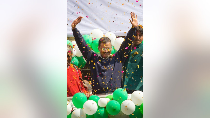 "Leader of the Aam Aadmi Party, or Common Man's Party, Arvind Kejriwal waves to the crowd as his party looks set for a landslide party in New Delhi, India, Tuesday, Feb. 10, 2015. The upstart anti-corruption party appeared set  to install a state government in India's capital in a huge blow for Prime Minister Narendra Modi's Hindu nationalist party. As early trends pointed to an overwhelming win for the AAP, the party's jubilant supporters began cheering and dancing in celebration, yelling ""Five Years Kejriwal."" (AP Photo/Manish Swarup)"