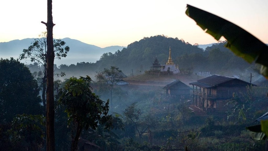 In this Jan. 12, 2015 photo, a Buddhist pagoda is nestled in the mist-shrouded hilltop village of Mar Wong, in northern Shan state, Myanmar. The area is controlled by the Ta'ang National Liberation army (TNLA), an ethnic insurgency that claims to have 4,000 troops and is refusing to sign a nationwide ceasefire citing the lack of ethnic minority aspirations in dialogues. (AP Photo/Gemunu Amarasinghe)